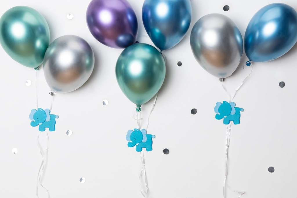 metallic pastel balloons taped to a wall as decorations.